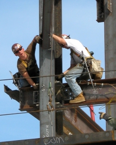 Construction Workers Wearing Hard Hats